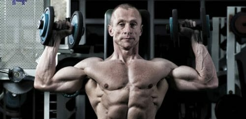 older guy lifting weights