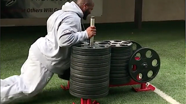 james Harrison pushing weighted sled